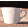 Mug with a word inlaid